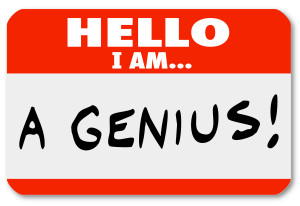A red nametag with the words Hello I Am A Genius that might be worn by a brilliant expert or very smart person, or someone who is a braggart and blowhard who thinks highly of him or herself